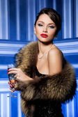 Girl with fur and champagne — Stockfoto