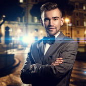 Gentleman in black suit on street — Stock Photo