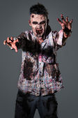 Aggressive, creepy zombie in clothes — Stock Photo