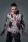 Aggressive, creepy zombie in clothes — Stock Photo