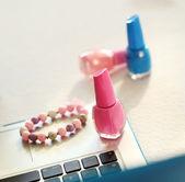 Laptop, bracelet and nail polish — Stock Photo