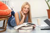 Beautiful blonde woman with books — Stok fotoğraf