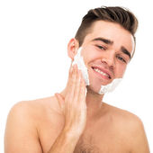 Man shaves his face — Stock Photo