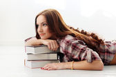Girl on the floor with books — Stock Photo