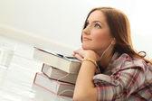 Girl listening music on floor — Stock Photo