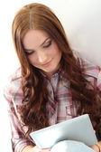 Girl on floor with tablet — Stock Photo