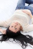 Cute female brunette on floor — Stock Photo