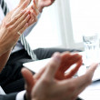 Hands of businesspeople applauding during a meeting — Stock Photo #41989159