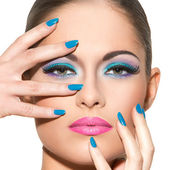 Beautiful girl with colorful makeup — Stock Photo