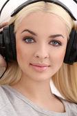 Blonde girl in headphones — Stock Photo