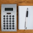 Workplace with notepad and calculator — Stock Photo #42837361