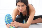 Brunette sport woman on floor — Stock Photo