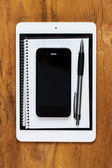 Phone, tablet and notepad — Stockfoto