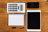 Phone, tablet and notepad — Stock Photo