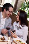 Beautiful couple in restaurant — ストック写真