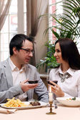Beautiful couple in restaurant — Stock Photo