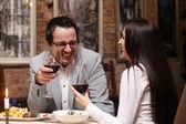 Attractive couple in restaurant — ストック写真