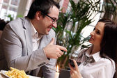 Attractive couple in restaurant — Stock Photo