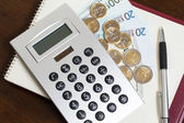 Money, notepad and calculator — Stock Photo