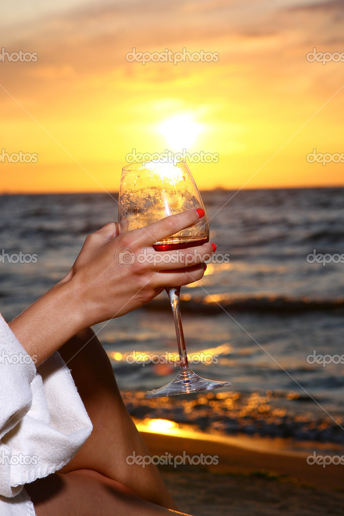 beautiful young woman drinking wine on beach male models