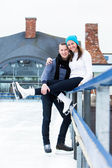 Beautiful couple on the ice rink — Stock Photo