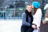 Beautiful couple on the ice rink — Foto de Stock