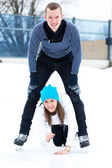 Active couple on the ice rink — Stock Photo