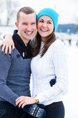 Attractive couple on ice rink — Stock Photo