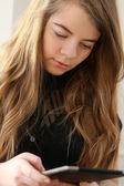 Teenage girl with ipad — Stockfoto