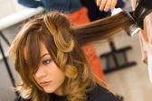 Woman during haircut — Stock Photo