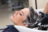 Woman during hair wash — Stock Photo
