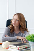 Beautiful woman in the office — Stock Photo