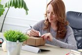 Beautiful woman with package — Stock Photo