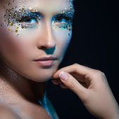 Beautiful girl with artistic make-up — Stock Photo