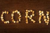 CORN word of popcorn — Stock Photo