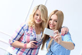 Best friends with mobile phone — Foto de Stock