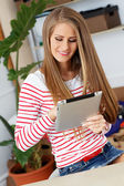 Woman with tablet and wide smile — Stock Photo