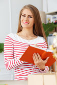 Attractive woman with notepad — Stock Photo