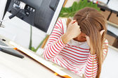 Tired woman at work in the office — Stock Photo