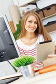 Attractive woman at work in office — Stock Photo