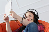 Woman with tablet and headset — Foto de Stock