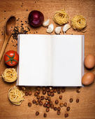 Cooking book and food — Stock Photo