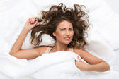 Cute woman in the bed — Stock Photo