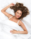 Cute woman in bed — Stock Photo