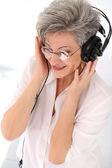 Elderly woman with headphones — Stock Photo