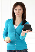 Woman with wallet and piggy bank — Stock Photo