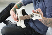 Guy on floor with electric guitar — Stock Photo