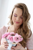 Young girl with flowers — Stock Photo