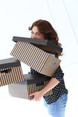 Clumsy woman with boxes — Stock Photo