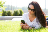 Attractive girl on the grass — Stock Photo